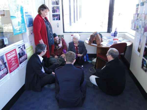 Praying inside Senator Bushby's office